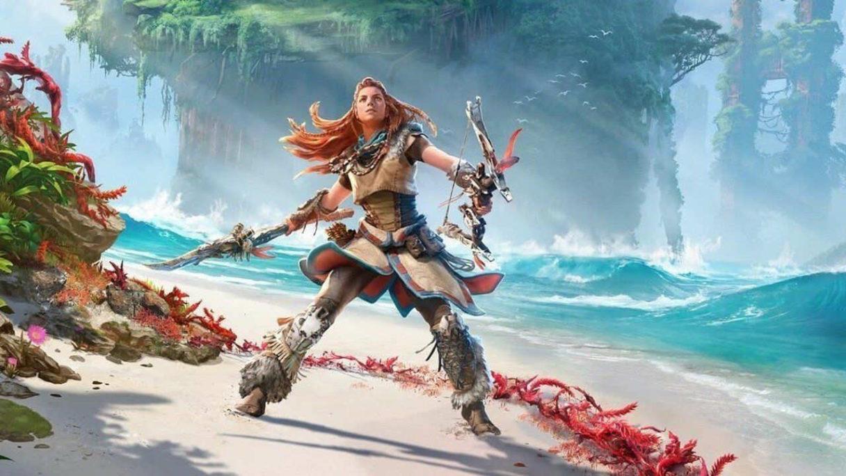 Horizon Forbidden West od PlayStation - Aloy na plaży z bronią