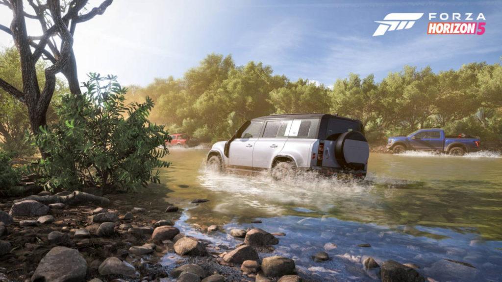 jadące samochody przez rzekę