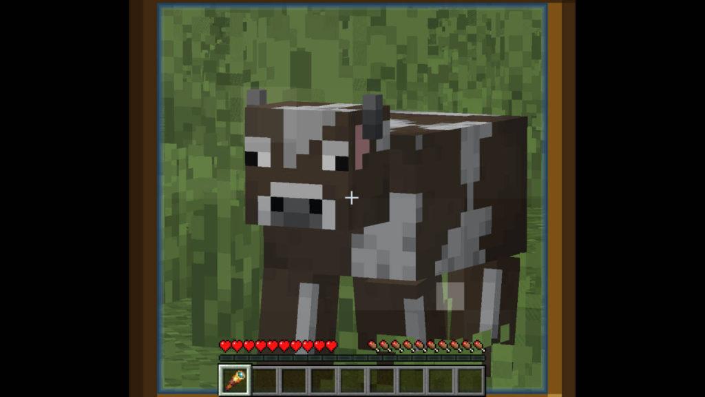Miedź w Minecraft - gracz patrzy przez lunetę na krowę