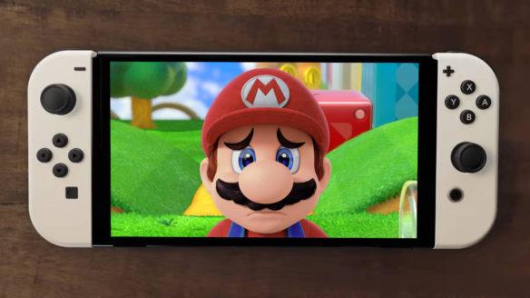 Nintendo Switch OLED - smutny Mario na ekranie konsoli