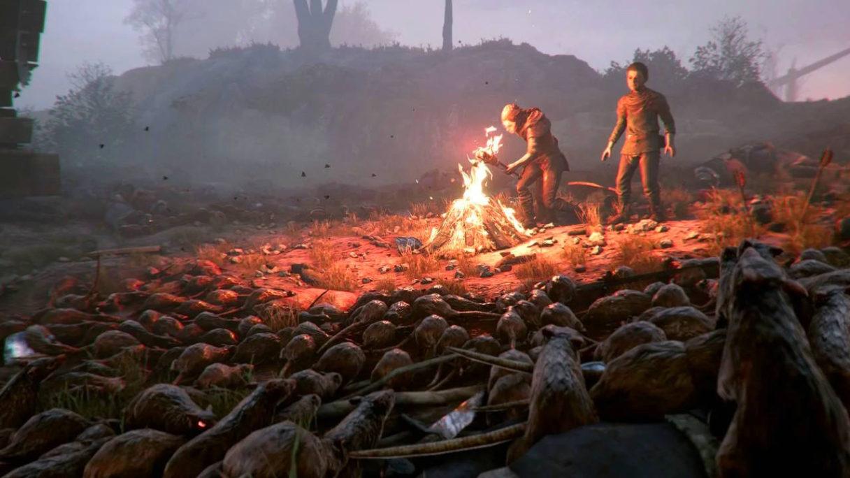 A Plague Tale Innocence - szczury zbierają się wokół ogniska i dwóch chłopców