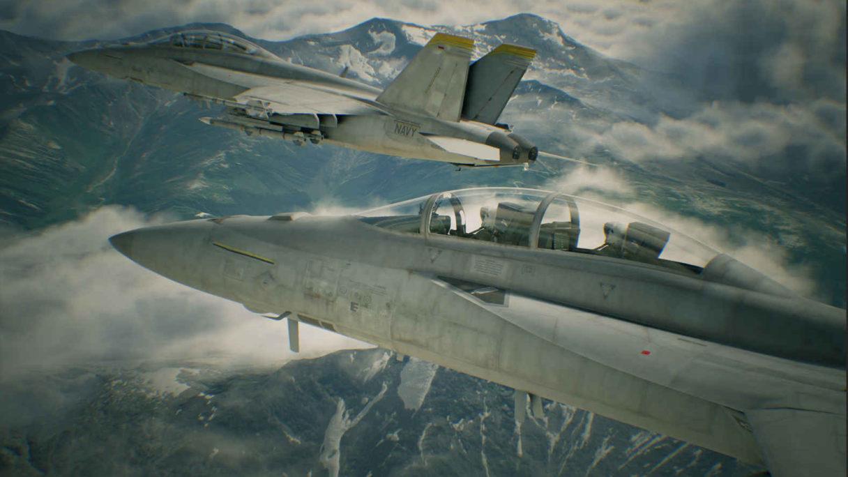 Dwa samoloty bojowe lecą nad chmurami.