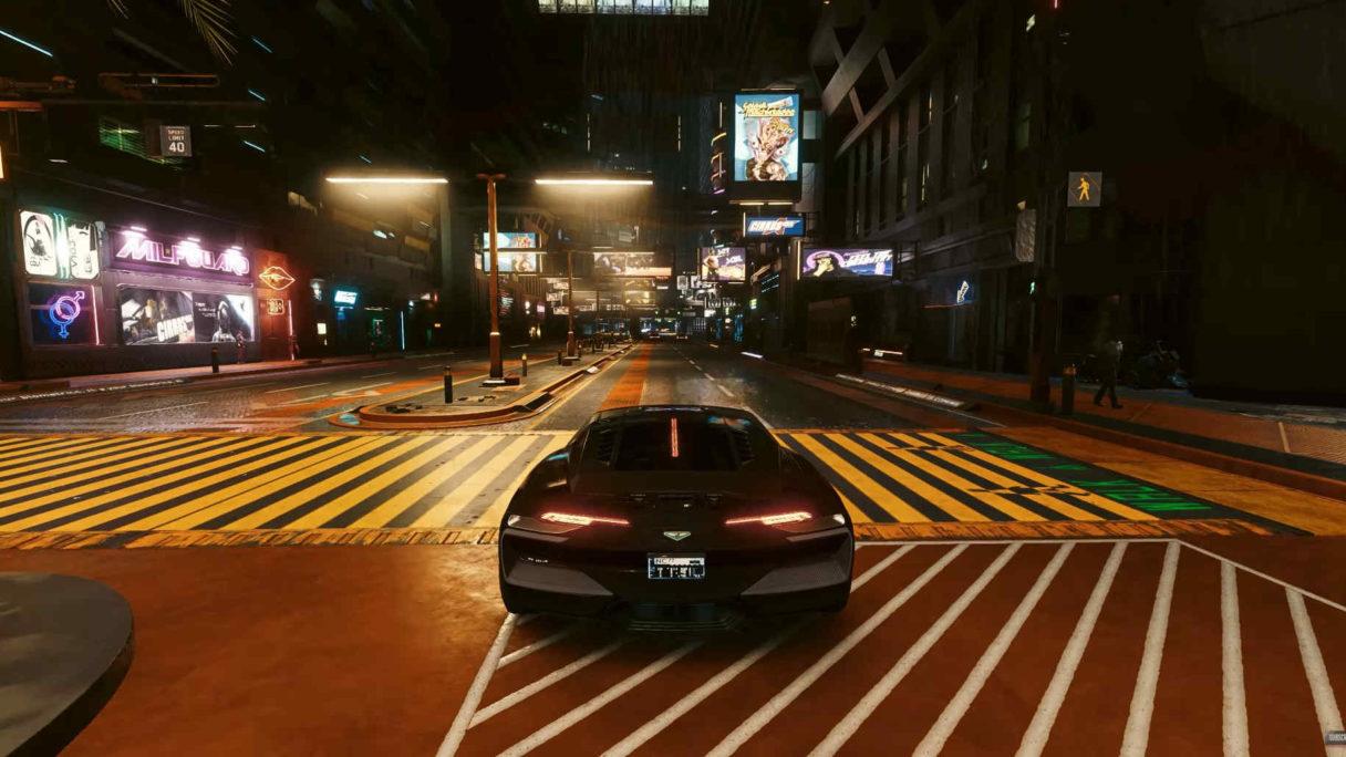 Czarny samochód jedzie po cyberpunkowym mieście