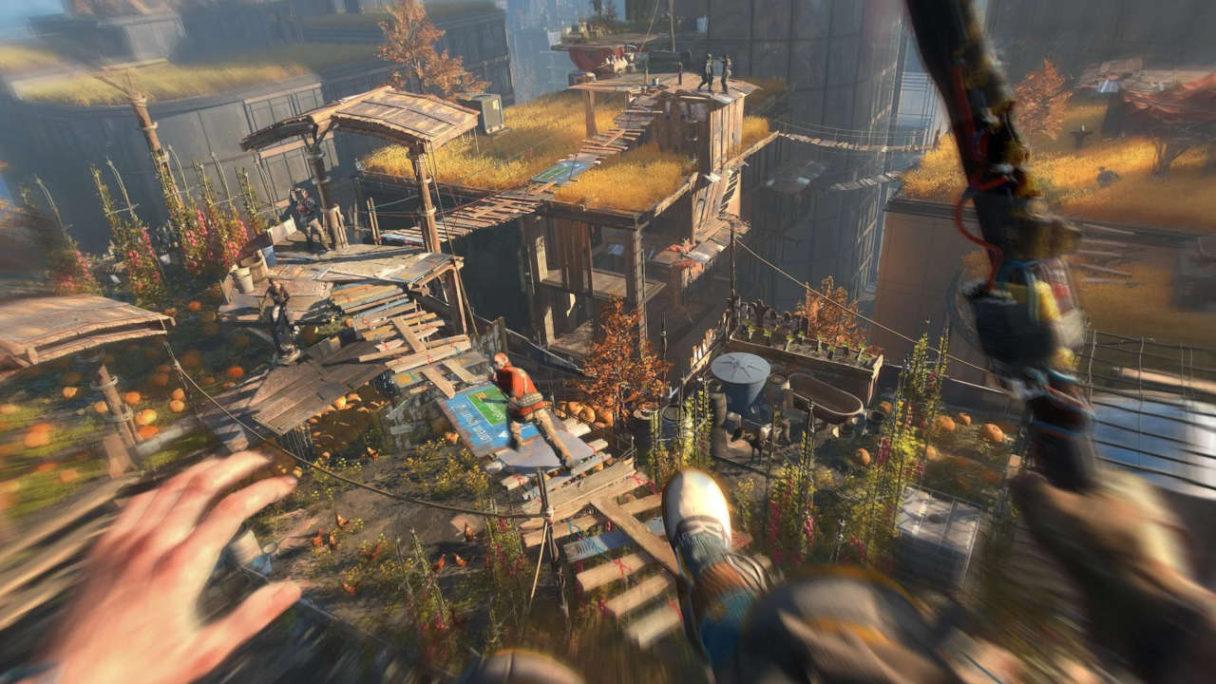 Dying Light 2 - parkur - gracz goni za przeciwnikiem skacząc z dużej wysokości wśród drewnianych mostków