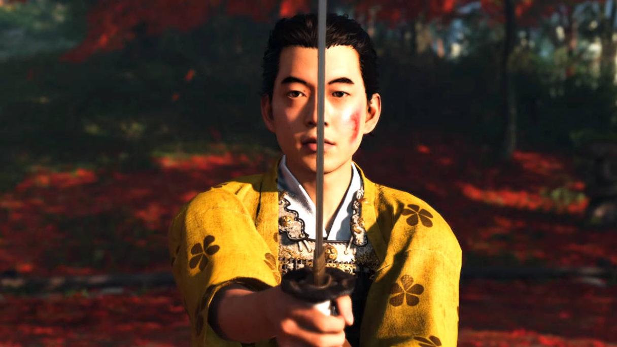 Ghost of Tsushima Director's Cut - mężczyzna w żółtym kimono trzyma katanę w bojowej pozycji