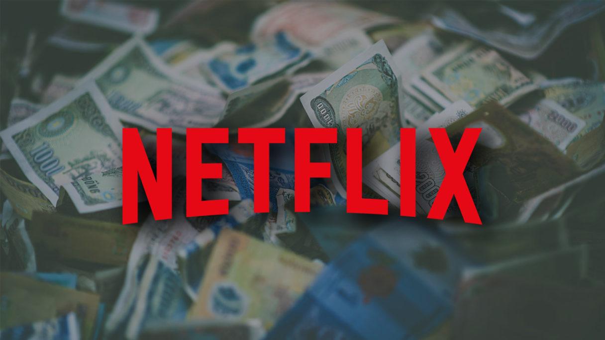 Netflix - logo na tle pieniędzy