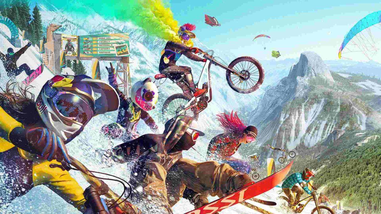 Rowerzyści zjeżdżają z ośnieżonej góry
