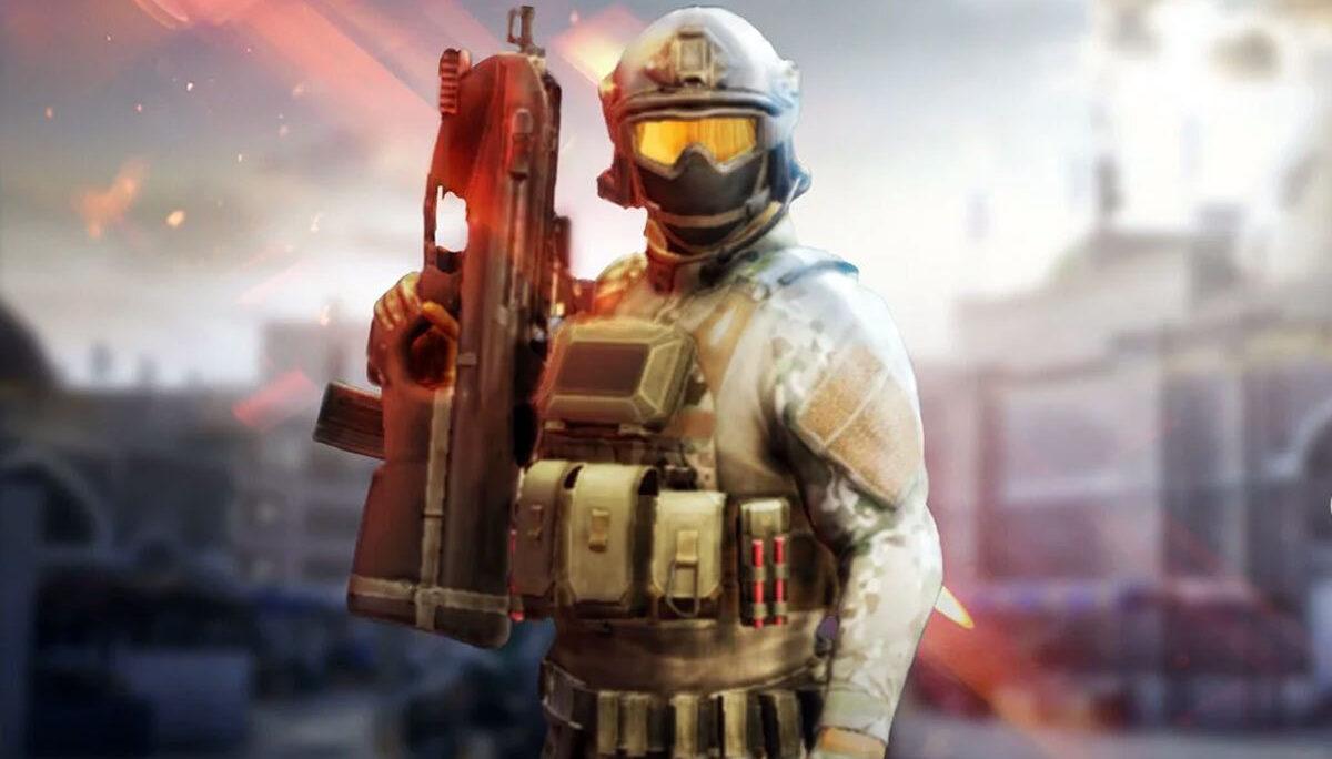 Żołnierz stoi z bronią.