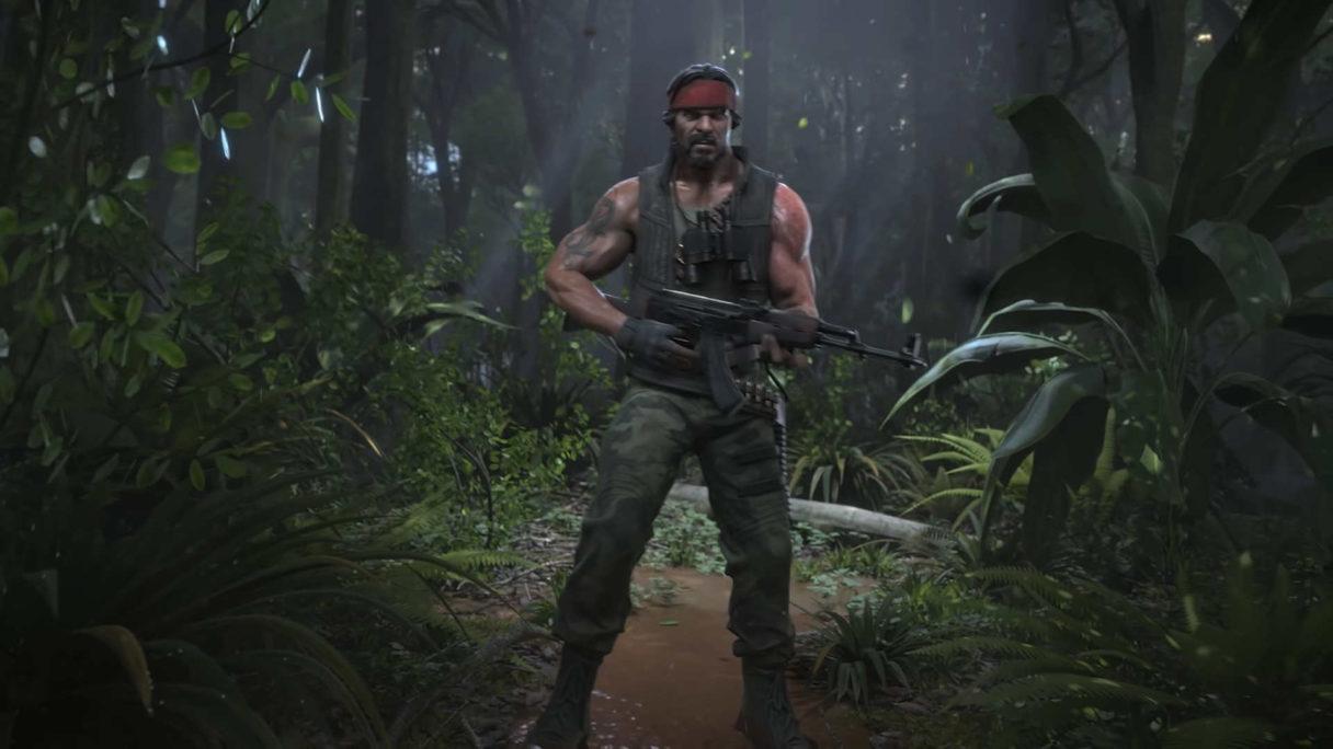 Terrorysta z AK47 stoi w jungli.
