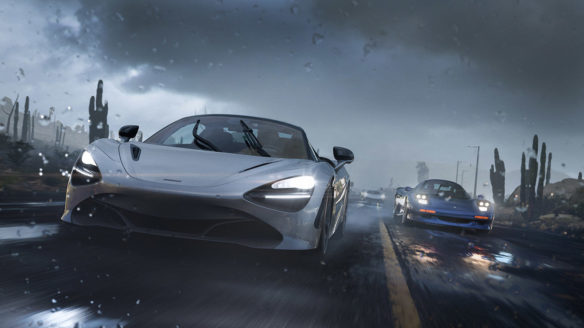 Dwa samochody sportowe ścigają się po mokrej ulicy.