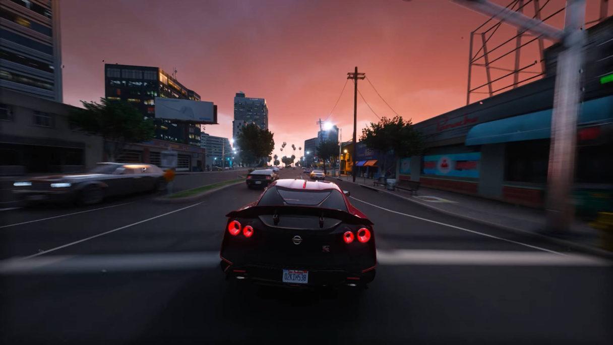 Czarny samochód sportowy jedzie przez ulicę.