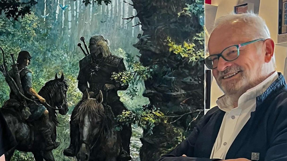 Wiedźmin i Thorgal na koniach (obraz), a obok Grzegorz Rosiński - PG